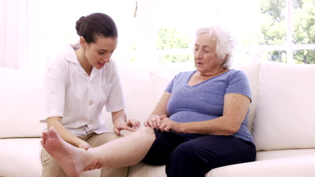Nurse checking senior womans leg video
