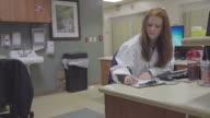 Nurse Doing Paperwork In Hospital video