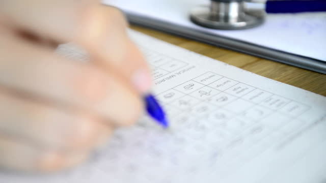 Nurse fills out medical paperwork video