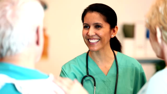 Nurse giving good news to a senior patient and spouse video