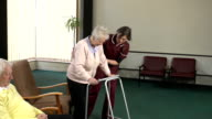Nurse helping an Elderly person with Walker / Zimmerframe video