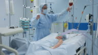 DS Nurse in intensive care giving infusion to young child video