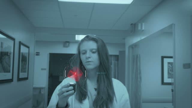 Nurse Looking at HUD in Hospital video