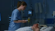DS Nurse measuring temperature of patient in intensive care video