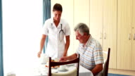Nurse offering a cake to his patient video