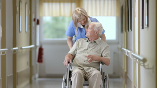 HD: Nurse Pushing Senior Man On Wheelchair video