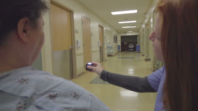 Nurse Showing Patient a HUD Display in the Hospital video