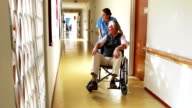 Nurse speaking with his patient in wheelchair video