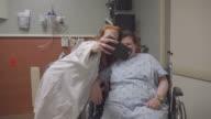 Nurse Taking Selfie With Patient In Hospital video