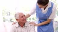 Nurse talking to senior man video