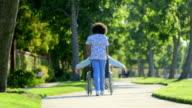 Nurse walking with elderly woman in wheelchair video