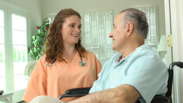 Nurse with Wheelchair Bound Male in Home video