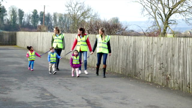 Nursery Group Walking with Children Wearing Safety Straps video
