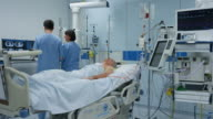 DS Nurses checking the male patient in intensive care video