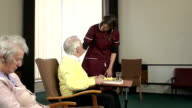 Nursing Care Home - Bringing food to elderly man video