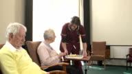 Nursing Care Home - Bringing food to elderly patient video