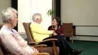 Nursing Care Home - Healthworker checks on elderly patient video