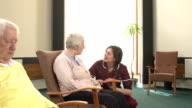 Nursing Care Home - helping an Elderly woman video