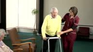 Nursing Care Home - Helping elderly man with Walker video