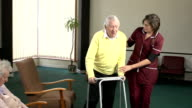 Nursing Care Home - Helping senior man with Walker Zimmerframe video