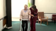 Nursing Care Home - Patient and Nurse with Walker / Zimmerframe video