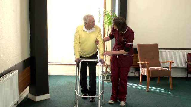 Nursing Care Home - Senior elderly man walking with Zimmerframe video