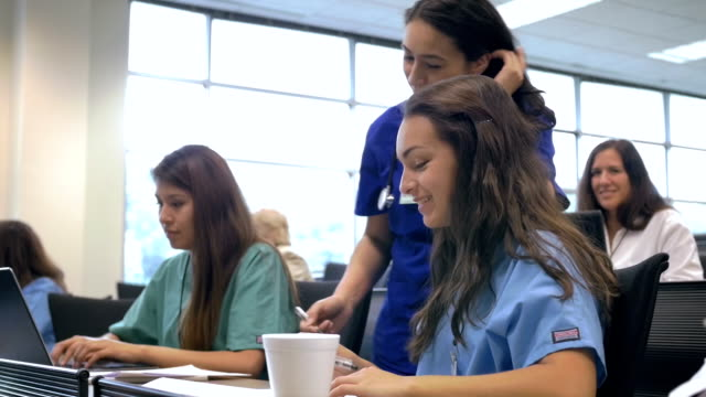 Nursing professor teaching medical students in lecture hall classroom video