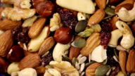 Nuts and seeds mix. Food background video