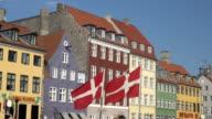 Nyhavn in Copenhagen - With Danish flags in foreground video