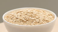 oat flakes in a bowl, close up video