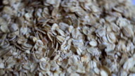 oat flakes in processing video