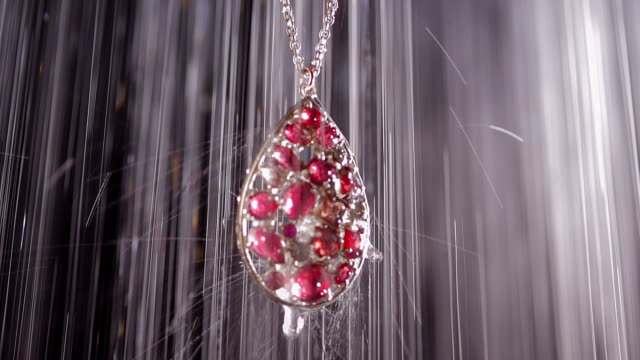Object Heavy rain on beautiful necklace at night video
