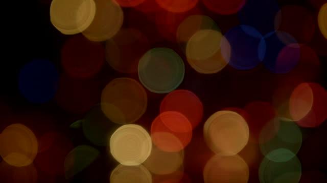 Objects Swinging blinking christmas lights defocus black background video