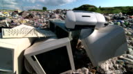 Obsolete desktop computer scrap at the landfill video