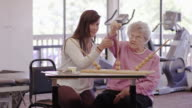Occupational therapist working with a geriatric patient in a clinic video