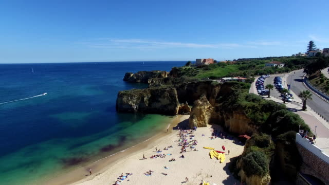 Ocean and beach near cliffs Lagos Portugal aerial view video