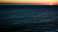 ocean half water with sunset sky video