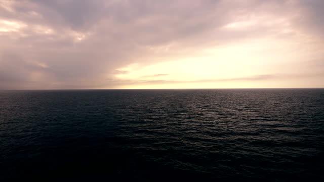Ocean ripple with Beautiful Clouds in orange pink Sky - Around Sunset/sunrise video