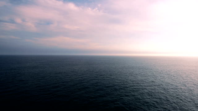 Ocean ripple with Beautiful Clouds in pink Sky video