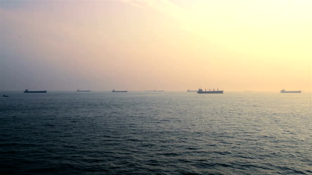 Ocean ripple with Beautiful Clouds in Sky and so many tank ships on horizon in dawn video