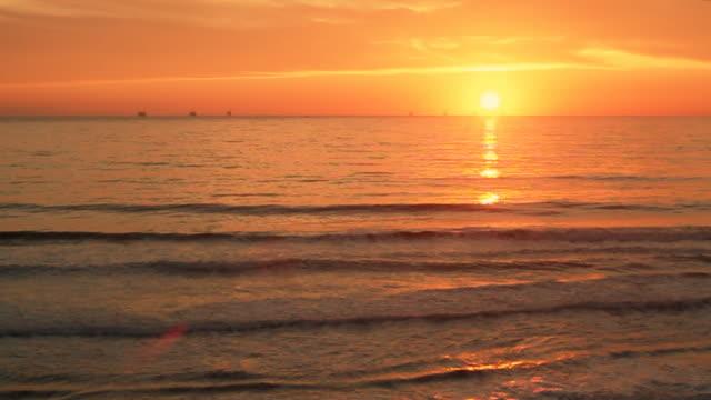 Ocean Sunset - Oil Rig Drilling Platforms on Horizon video