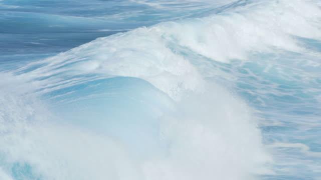 Ocean waves breaking in rough sea video