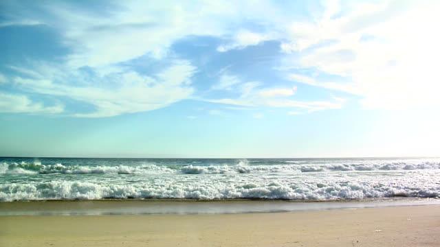 Ocean waves breaking on sandy beach video