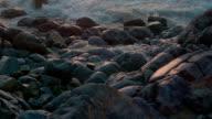 Ocean Waves Crash Into Rocks During Sunset video