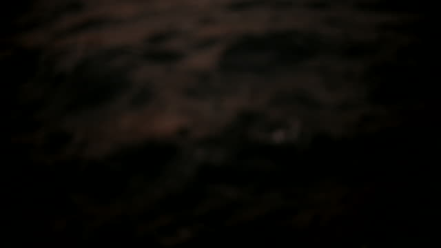 Ocean waves in slow motion at night video