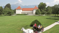 AERIAL of a horse carriage ride through a castle park video