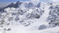 AERIAL of busy ski resort on sunny day video