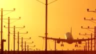 Off Center Twin Engine Jet Landing Sunset video