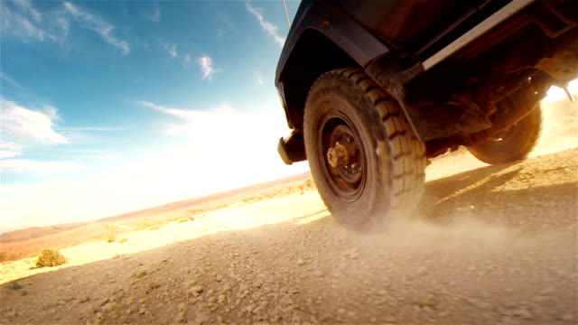 Off road in desert in Africa. Tread on the tire close-up. video