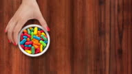 Offering multicolored candy video
